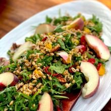 FARRO, GRILLED PEACH AND PECANS dressed with chili-lime pickled shallots